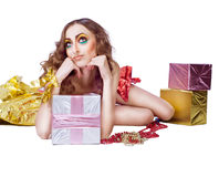 Fashion woman model lying in studio Stock Photography