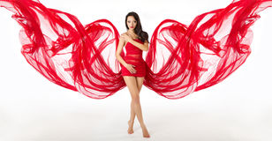 Fashion Woman Model Posing in Red Dress, Cloth Wings stock photo