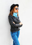 Fashion woman model posing wearing black rock jacket, hat over white Stock Photos