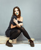 Fashion woman model sitting. Grunge Stock Photos