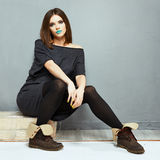 Fashion woman model sitting. Grunge Stock Images