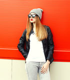 Fashion woman model wearing a sunglasses, hat over red Royalty Free Stock Photos