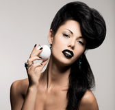 Fashion woman with modern hairstyle  with white apple Royalty Free Stock Images