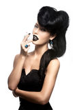 Fashion woman with modern hairstyle  with white apple. Portrait of fashion woman with modern hairstyle and  lips in black color with white apple Royalty Free Stock Image