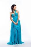 Fashion woman in modern long dress posing Royalty Free Stock Photo