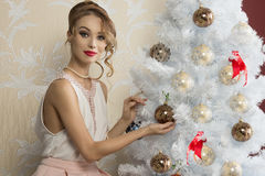 Fashion woman near christmas tree Royalty Free Stock Photo