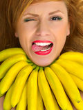 Fashion woman with necklace of small yellow bananas smiling Stock Photography