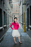 Fashion woman in old alley Stock Photos