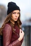 Fashion woman outdoor portrait. Beautiful girl posing on the str. Young beautiful woman posing outdoors. stylish fashion portrait Royalty Free Stock Photo