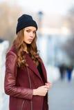 Fashion woman outdoor portrait. Beautiful girl posing on the str. Young beautiful woman posing outdoors. stylish fashion portrait Stock Photos