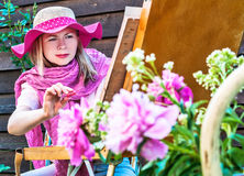 Fashion woman is painting. Royalty Free Stock Photos