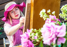 Fashion woman is painting. Royalty Free Stock Photography