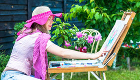 Fashion woman is painting. Stock Photos