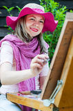 Fashion woman is painting. Royalty Free Stock Photo