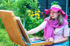 Fashion woman is painting. Royalty Free Stock Images