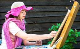 Fashion woman is painting. Stock Image