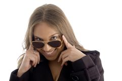 Fashion woman peeping over sunglasses Stock Image