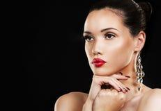 Fashion woman with perfect skin wearing dramatic makeup Stock Photo
