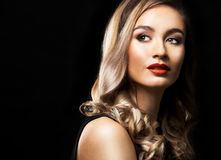 Fashion woman with perfect skin wearing dramatic makeup Stock Photography