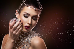Fashion woman with perfect skin wearing dramatic makeup Royalty Free Stock Image