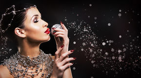 Fashion woman with perfect skin wearing dramatic makeup Stock Photos