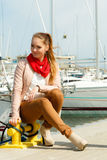 Fashion woman on pier against yachts in port Royalty Free Stock Photo