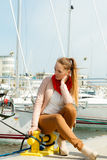 Fashion woman on pier against yachts in port Stock Images