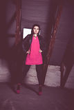 Fashion woman in pink dress and leather jacket at loft Royalty Free Stock Photos