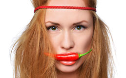 Fashion woman placing bite red chili between in her mouth Royalty Free Stock Photos