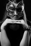 Fashion woman portrait. Beautiful woman portrait with Carnival mask looking at you on black and white Royalty Free Stock Photo