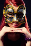 Fashion woman portrait. Beautiful woman portrait with Carnival mask looking at you Royalty Free Stock Image