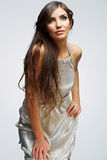 Fashion woman portrait against gray. Female young  Stock Photography