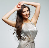 Fashion woman portrait against gray. Female young model. Royalty Free Stock Photo