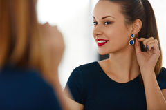 Fashion Woman Portrait. Beautiful Elegant Female Smiling. Jewelr Royalty Free Stock Photo