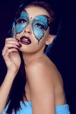 Fashion woman Portrait. Butterfly makeup,  face art make up Royalty Free Stock Photo