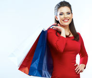 Fashion woman portrait isolated. White background. Happy girl h. Old shopping bag. Red dress. female beautiful model royalty free stock photo