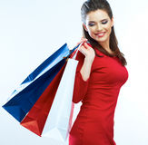 Fashion woman portrait isolated. White background. Happy girl h. Old shopping bag. Red dress. female beautiful model stock image
