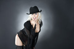 Fashion woman portrait wearing black hat Stock Image