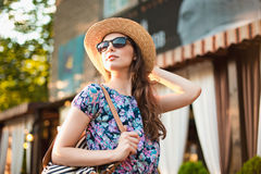 The fashion woman portrait of young pretty trendy girl posing at the city in Europe Stock Image