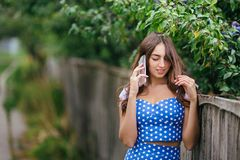 Fashion woman portrait of young pretty trendy smiling girl speak royalty free stock photo