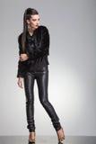 Fashion woman posing on grey studio backgroud Stock Photo