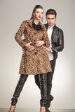 Fashion woman posing while her boyfriend is holding her Royalty Free Stock Photography
