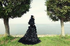 Fashion woman posing near the sea. Stock Photo