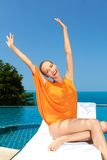 Fashion woman posing next to pool Royalty Free Stock Image