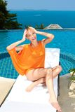 Fashion woman posing next to pool Royalty Free Stock Images