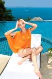 Fashion woman posing next to pool Royalty Free Stock Images