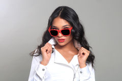 Fashion Woman Posing with Sun Glasses in Studio Royalty Free Stock Photo