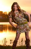 Fashion woman posing on sunset Royalty Free Stock Image