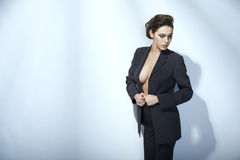 Fashion woman posing in unbuttoned jacket. Sensual fashion woman posing in unbuttoned jacket Royalty Free Stock Images