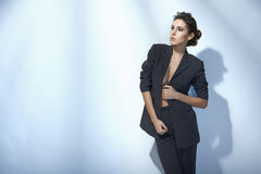 Fashion woman posing in unbuttoned jacket. Sensual fashion woman posing in unbuttoned jacket Royalty Free Stock Photography